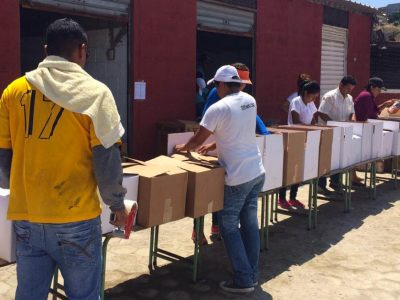people packing boxes for relief effort