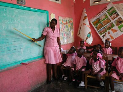 woman teaching children in a classroom