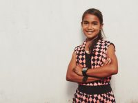 girl standing with arms crossed