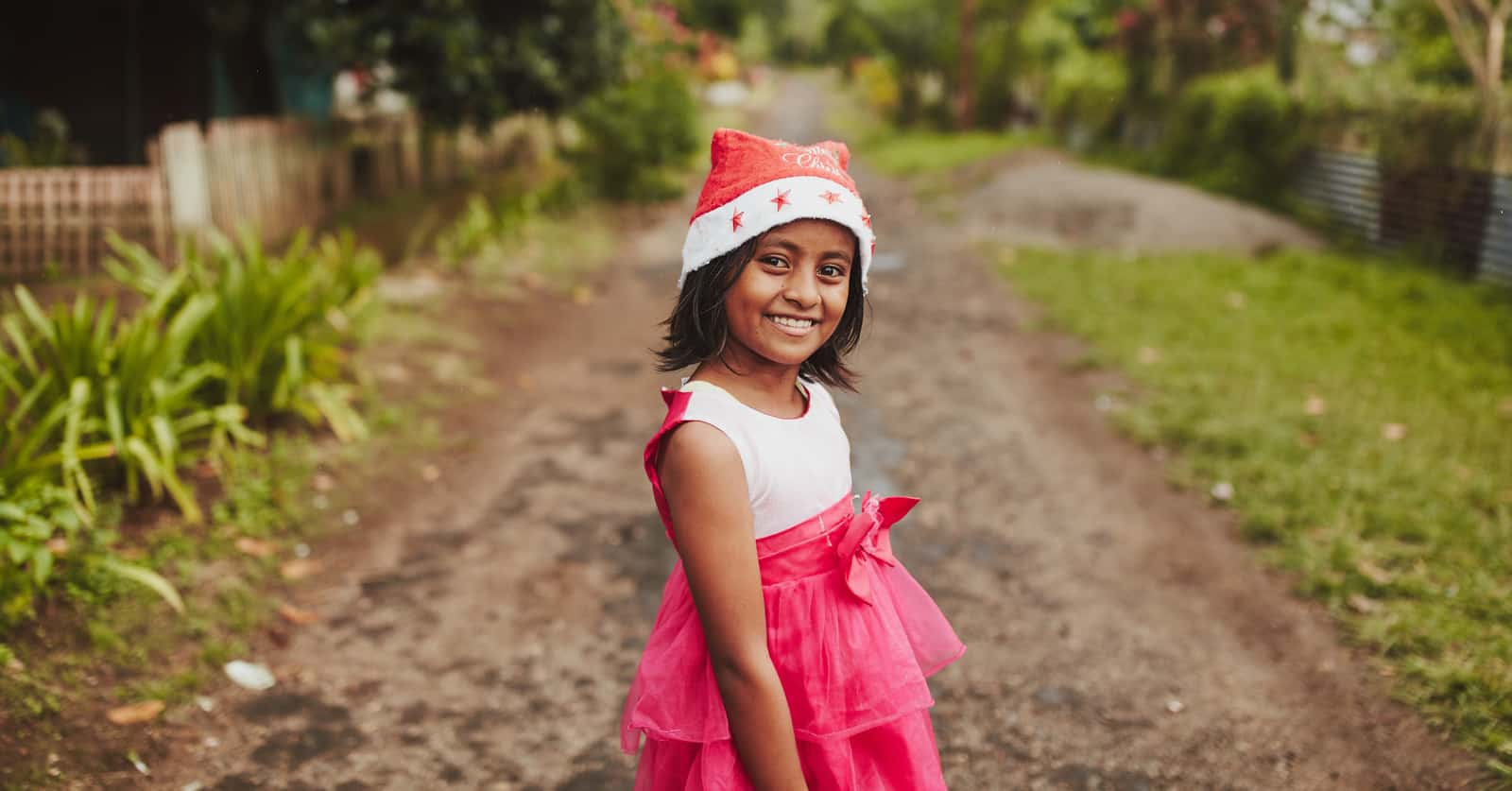 girl wearing a red dress and Santa hat