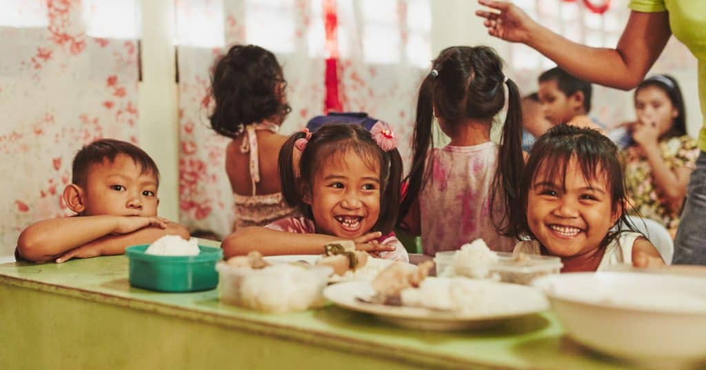 One word to move us in 2018: compassion Children Eating