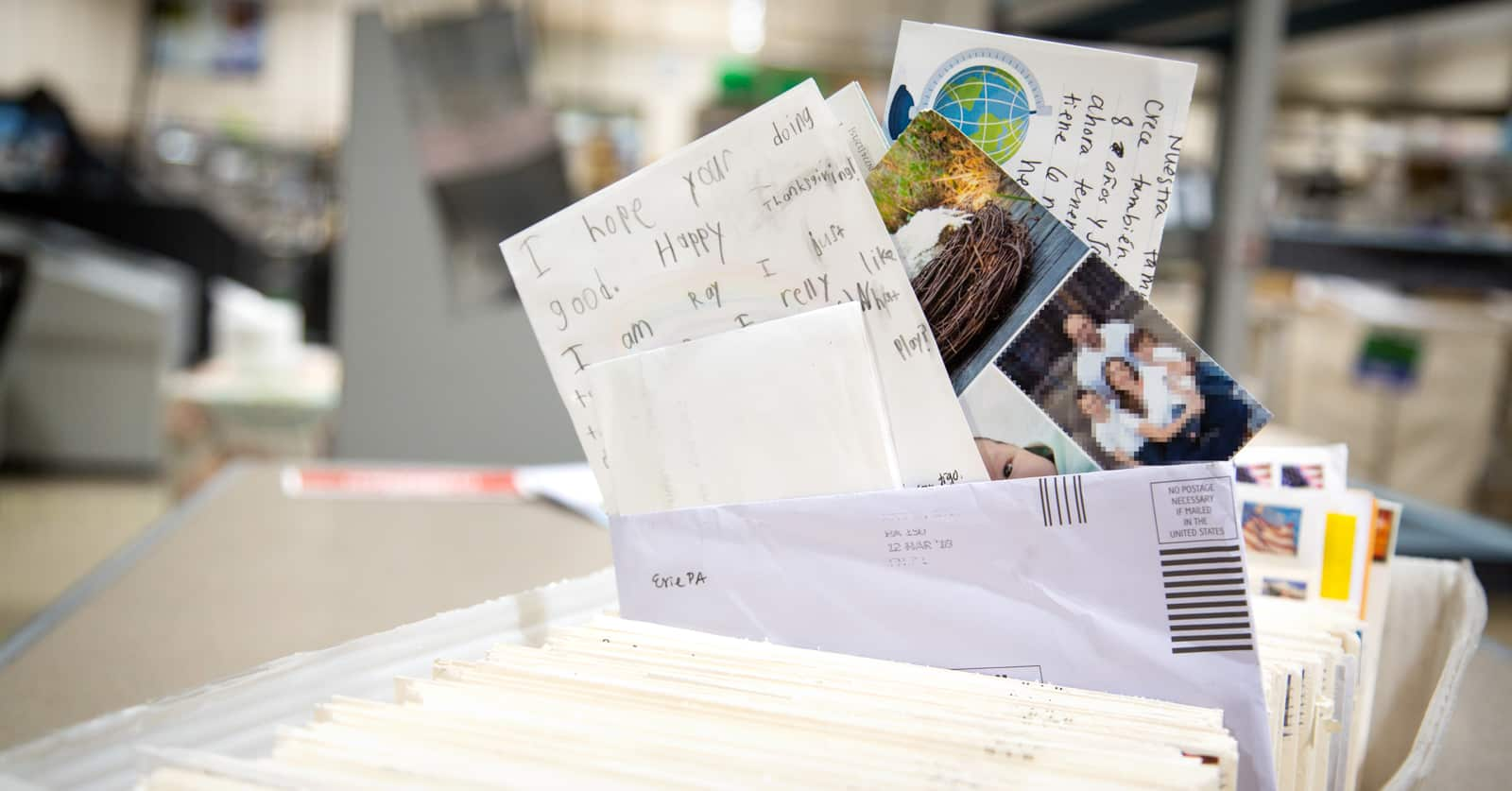 How Long Does It Take for My Letters to Be Delivered? A file folder full of letters and pictures.