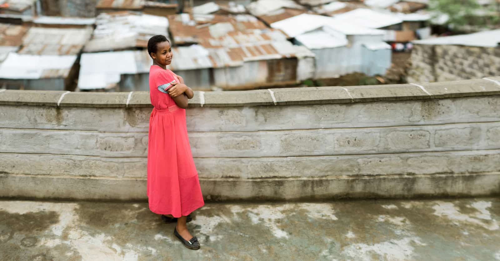 A teenage girl in a pink dress