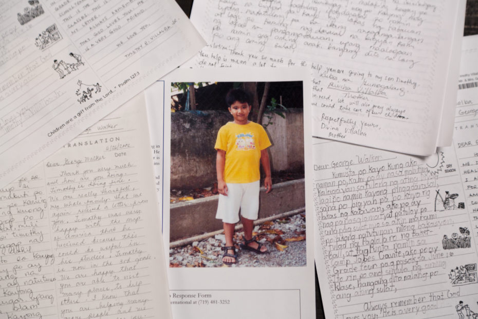 sponsor letters around a picture of a boy wearing an orange shirt and white shorts