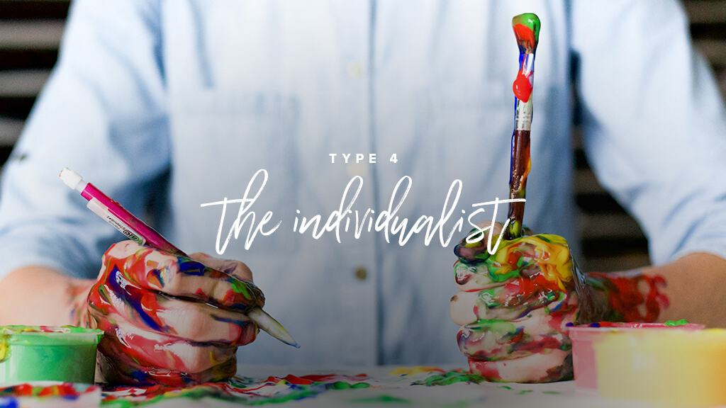 Someone sits at a table, holding paint brushes in each hand, covered in paint. Text: Type 4: The Individualist