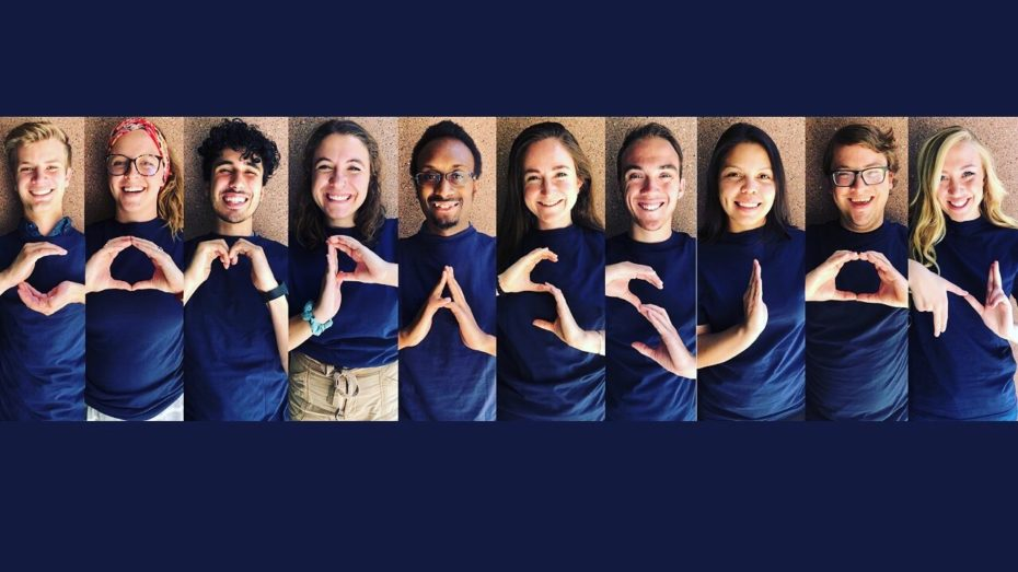 10 young people form the word 'Compassion' using their hands.