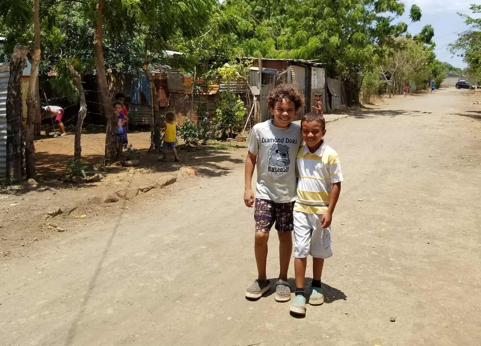 Two boys stand on a dirt road in Nicaragua.