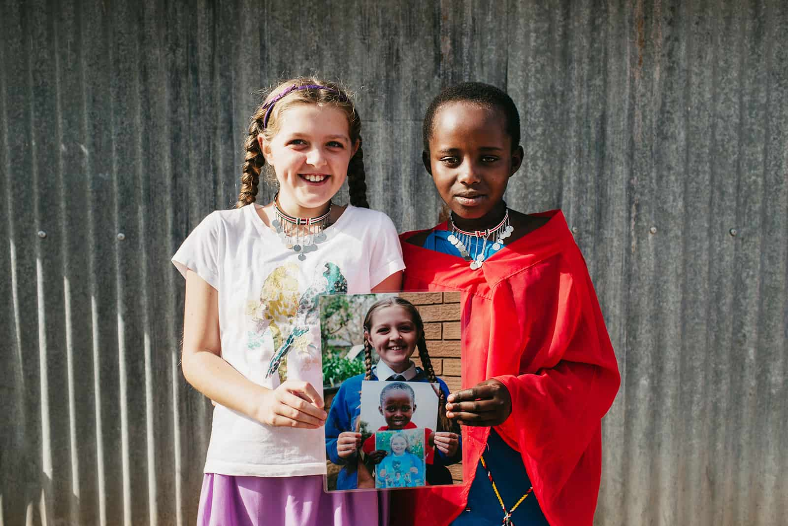 A young girl with her sponsored child