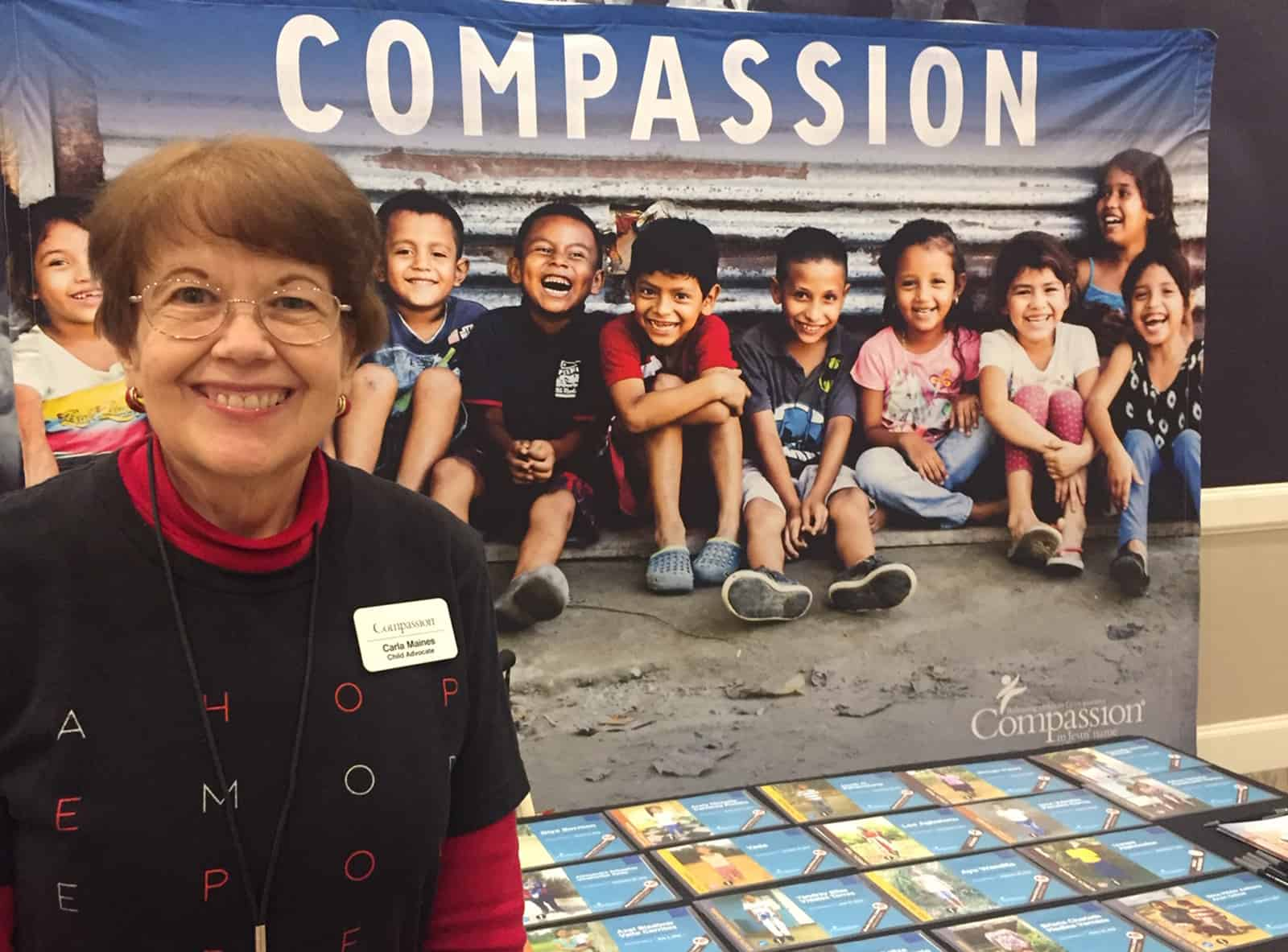 Carla Maines at a Compassion event table