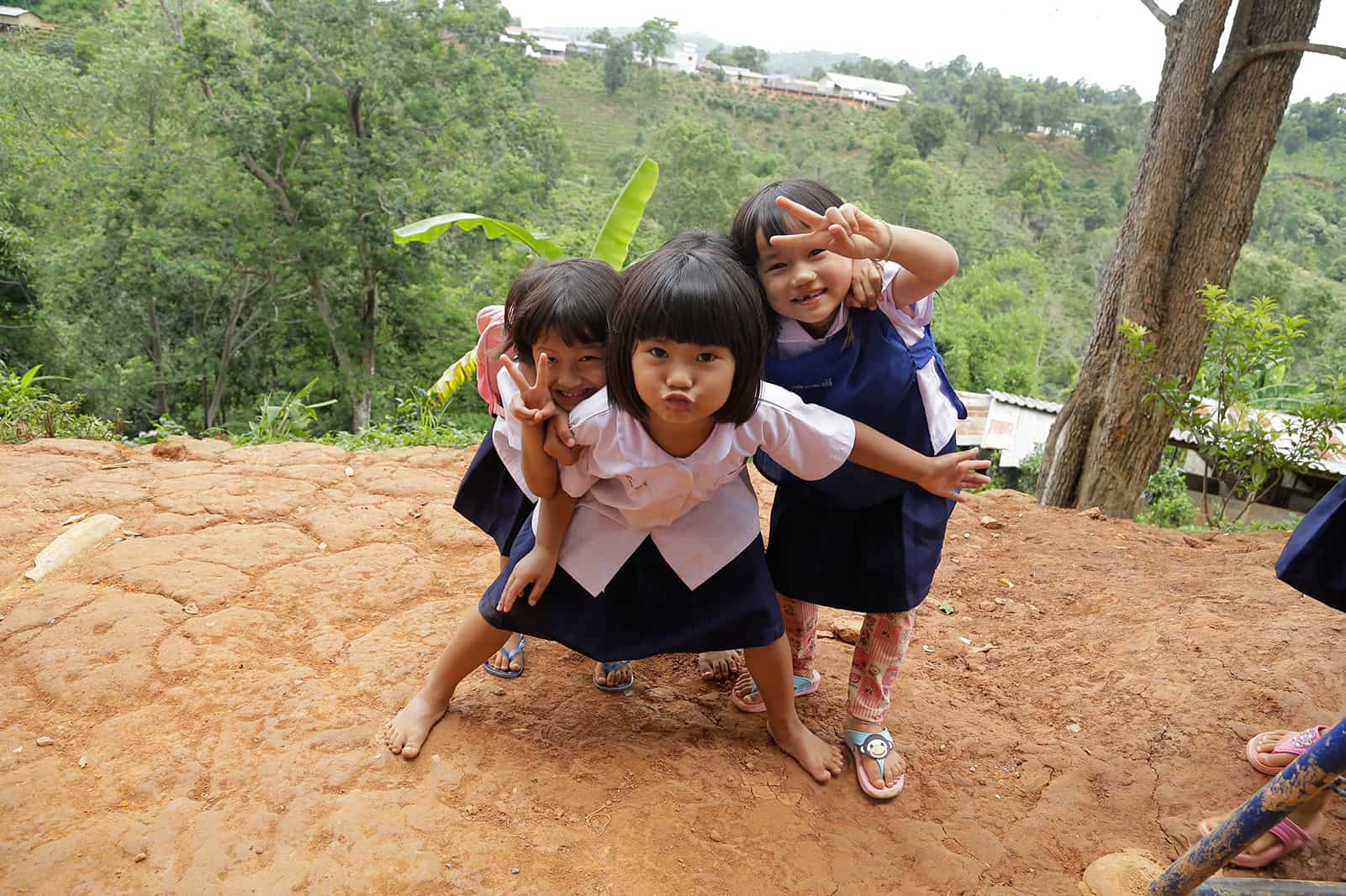 Grils in Thailand showing the peace sign