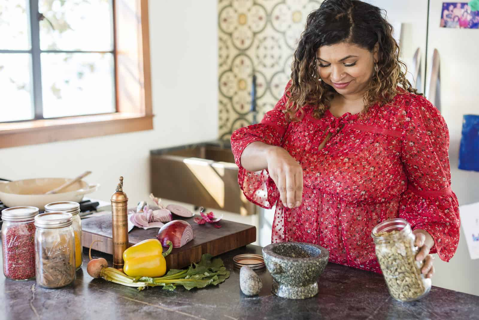 Aarti Sequeira cooks in a kitchen