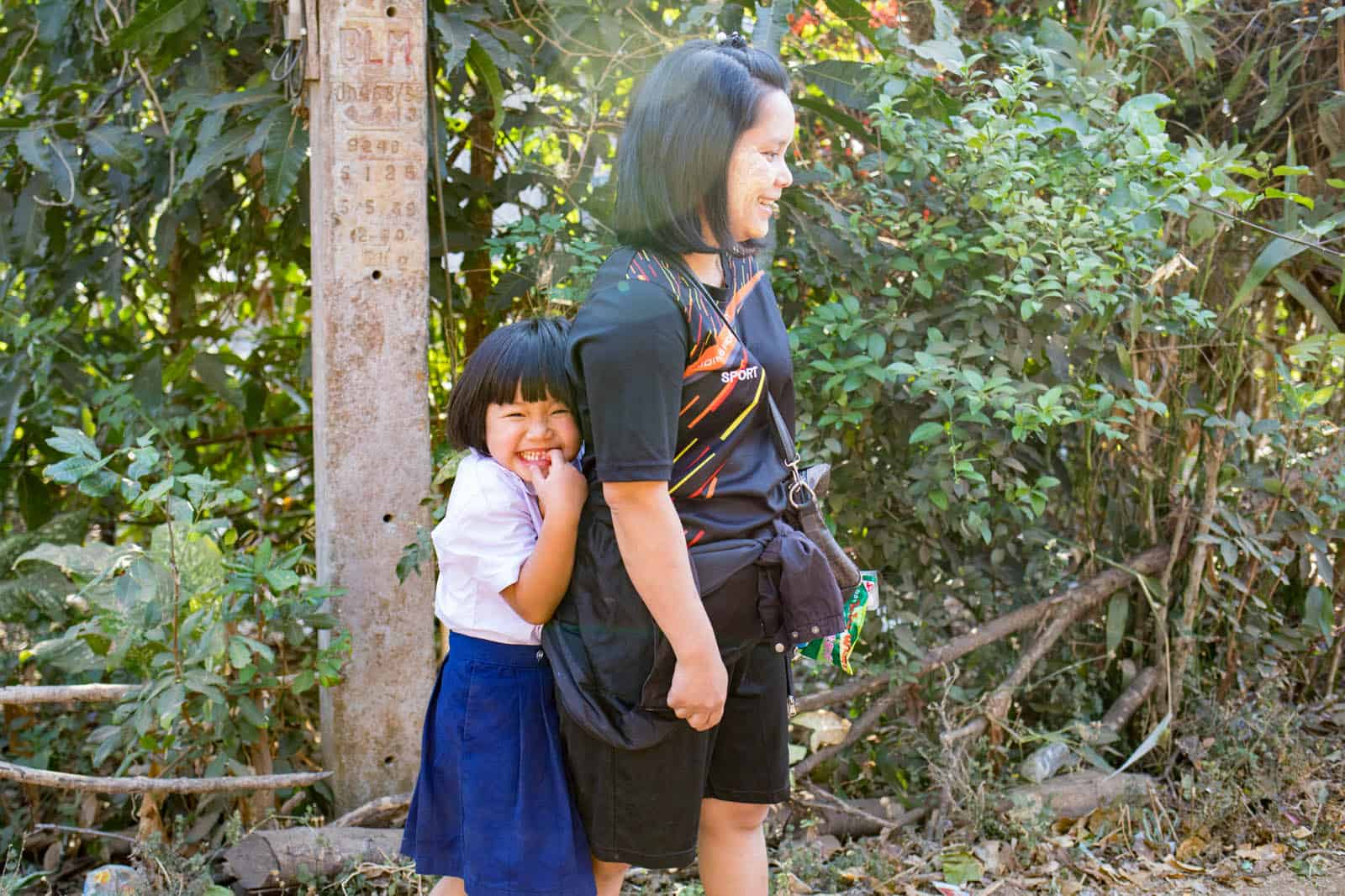 Sureeporn standing behind her mother giggling