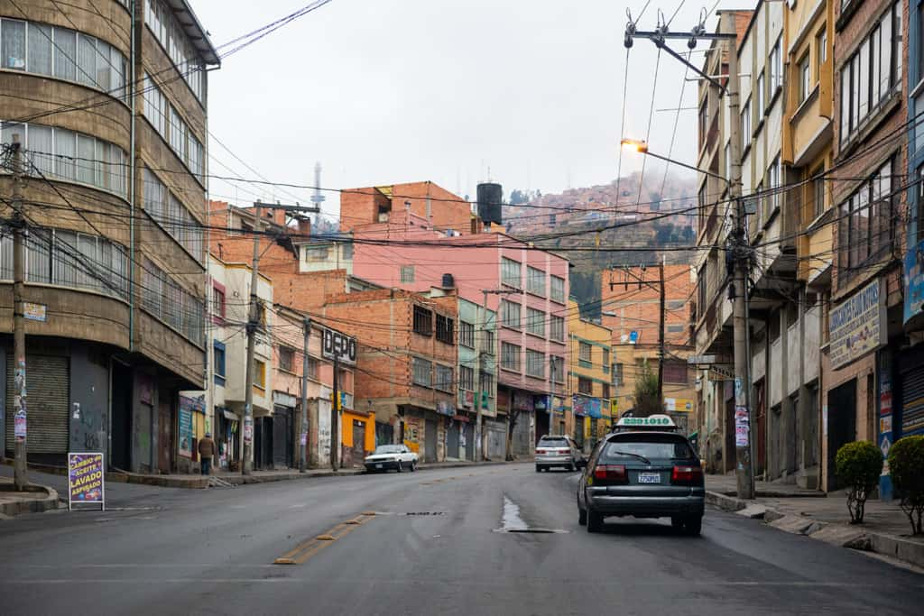 Street scene with cars and buildings in a neighborhood in La Paz, Bolivia