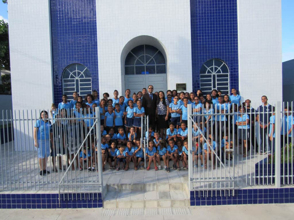 Children and staff in front of a church in Brazil.