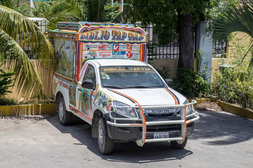 Brightly colored truck used as a taxi