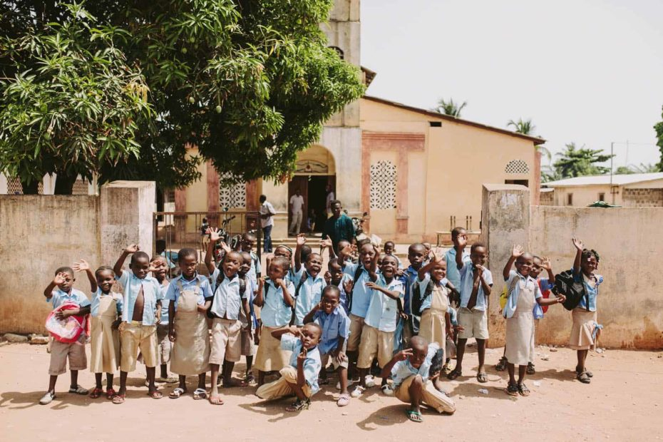 A group of children in front of a church
