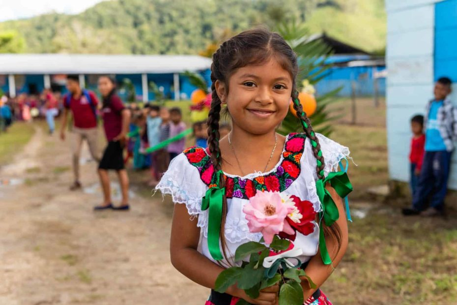 A smiling girl in traditional Mexican clothing