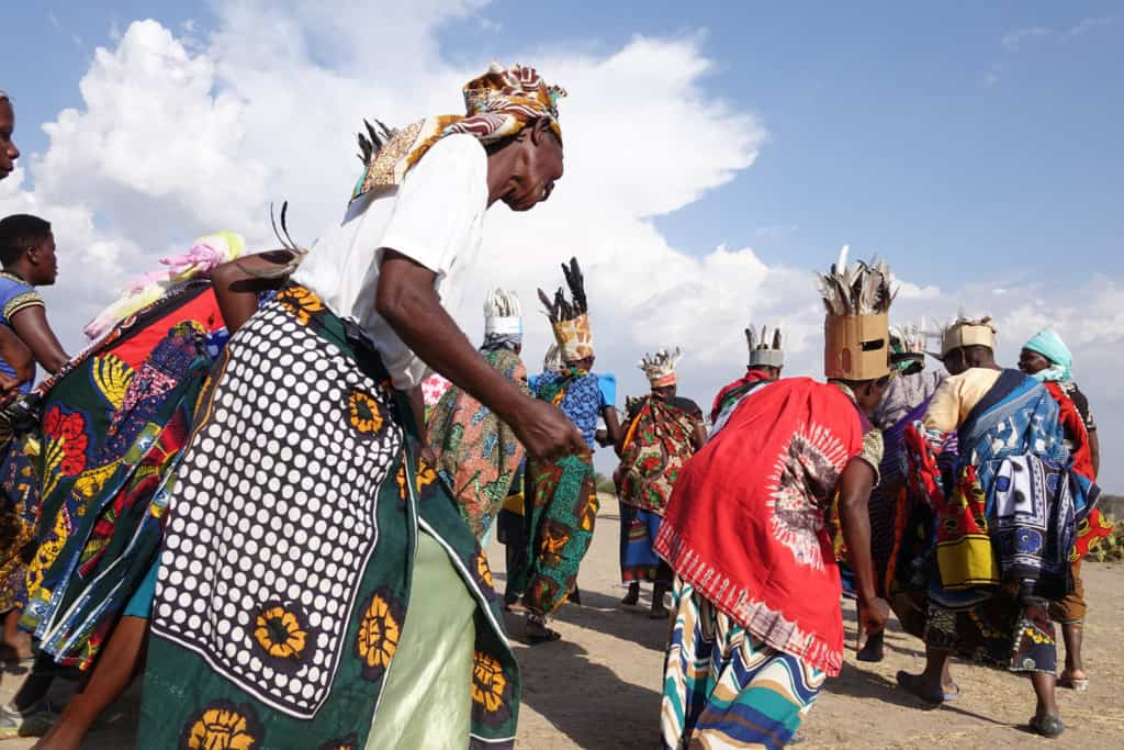 Women outside the Serengeti National Park celebrate in dance and song for a festival.