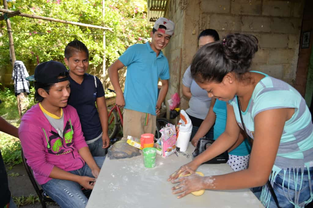 A Compassion center tutor visits the home of Junior, a teen in the program. Junior's family is making a meal