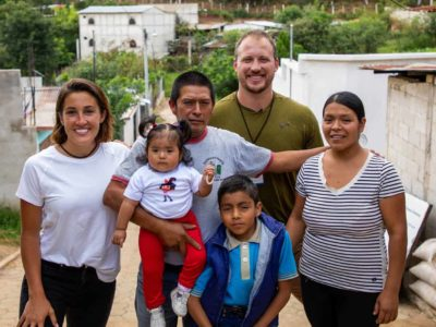 Nate Solder, his wife Lexi and a family in Guatemala