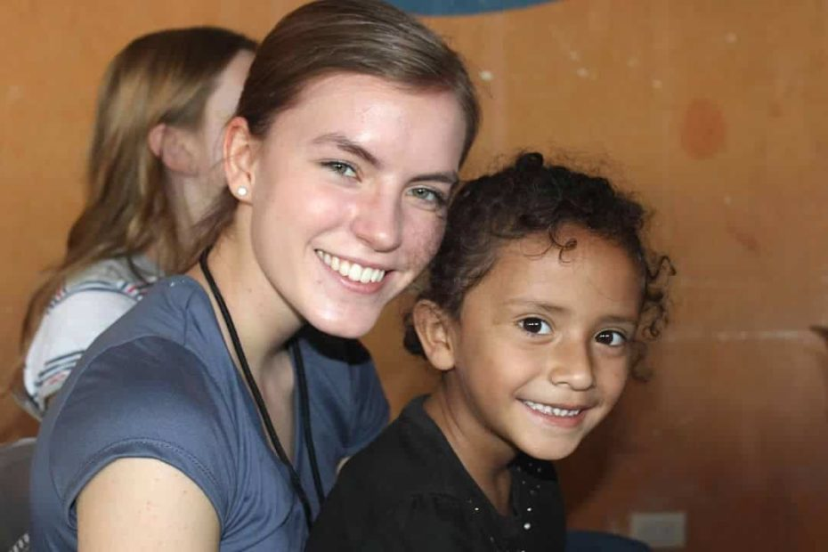 A woman and the child she sponsors through Compassion smile.