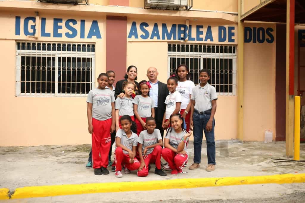 Some of the children and staff pause for a photo in front of the church that hosts your child's Compassion center.