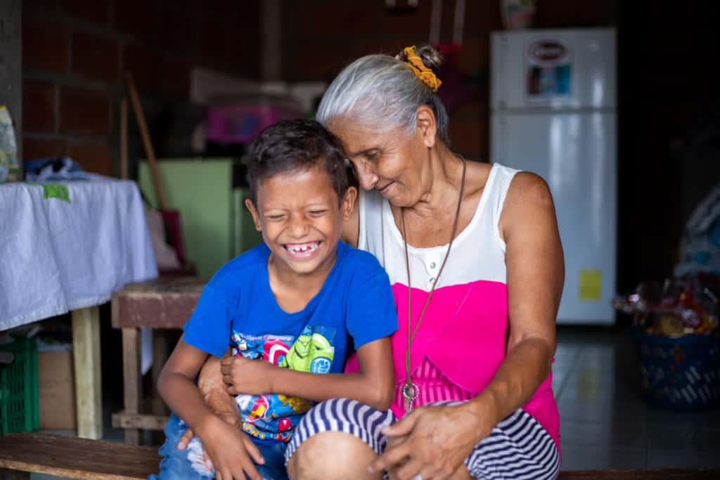 Jesus and his grandmother in their home in Ecuador
