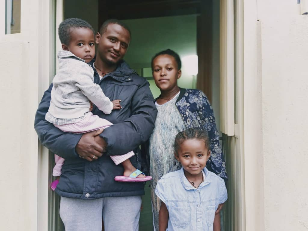 Sintayehu with his wife and their two children at home in Ethiopia